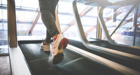 A girl running on a treadmill.