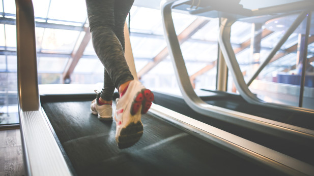 A girl running on a treadmill.